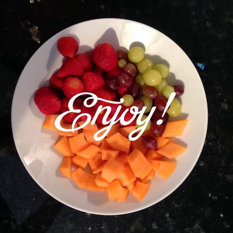 Bowl of fruit with the word enjoy written on it, dietitian's life.